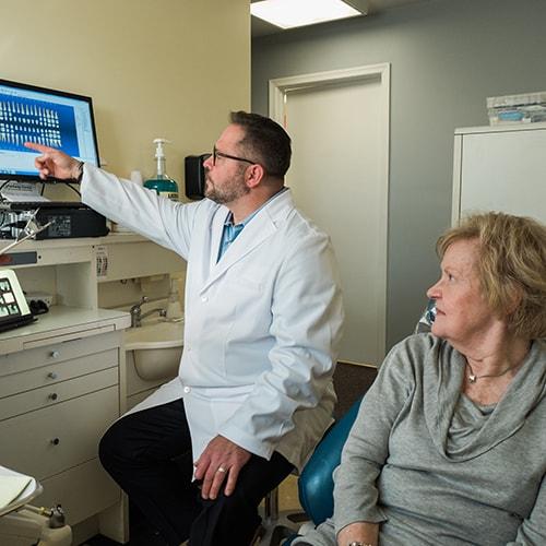 Dr. Infantino explain a treatment procedure to a new patient.