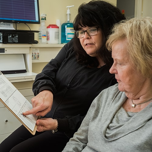 Leslie, a dental team member helping a new patient with some paperwork.