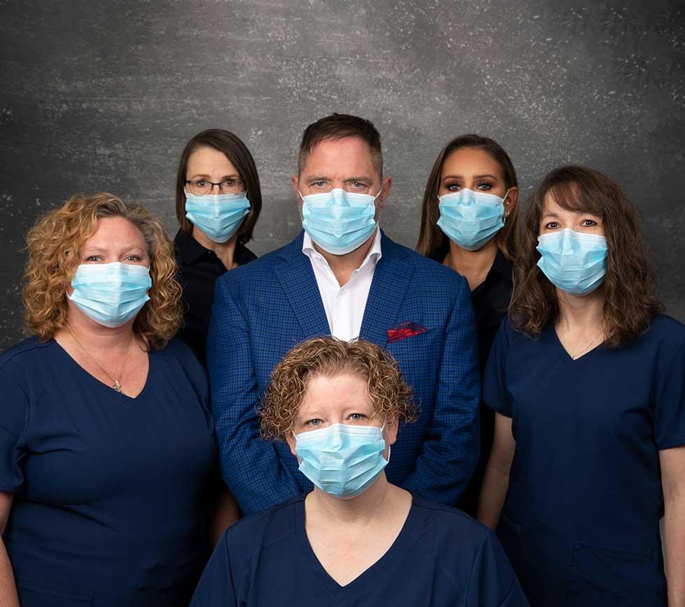 smiles-by-infantino-team-wearing-dental-masks