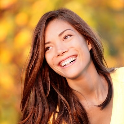 A young woman with porcelain veneers