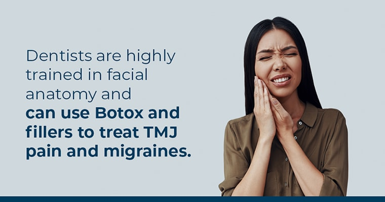 A woman in TMJ pain and holding her jaw before getting dermal fillers and botox